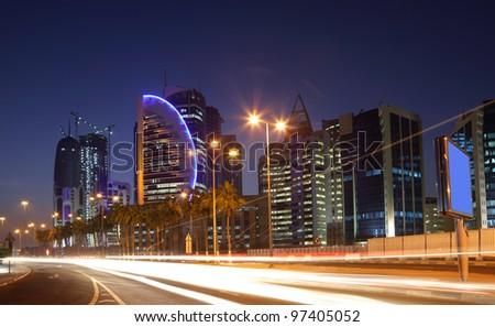 Street in Doha downtown at night, Qatar - stock photo