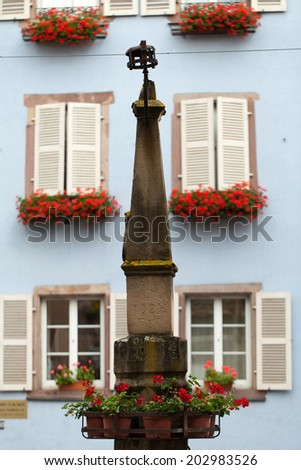Street  in Eguisheim village along the famous wine route in Alsace, France - stock photo