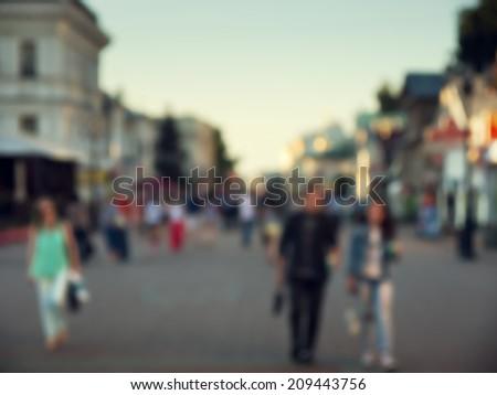 Street in european city in bokeh - stock photo