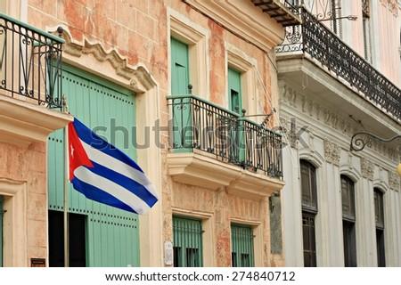 street in Havana with Cuba flag - stock photo