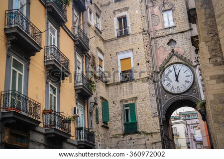 Street in historic center of Naples, Italy. Naples historic city center is the largest in Europe, and is listed by UNESCO as a World Heritage Site. - stock photo