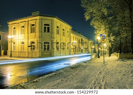 Street in Siedlce, Poland covered with snow at night