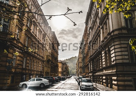street in the city when the sun shines and the rain - stock photo