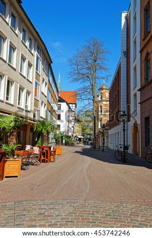 Street in the Old City center in Hanover in Germany. Hannover or Hannover is a city in Lower Saxony of Germany. Tourists nearby
