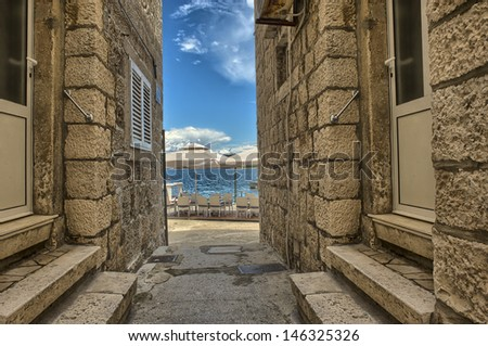 Street in the old town Korcula, Croatia  - stock photo