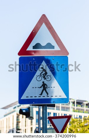 Street intersection congested with street signs - stock photo
