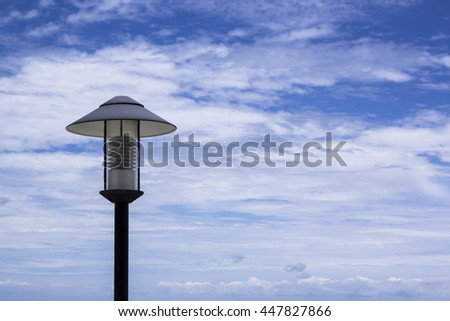 Street lamp, blue sky, white clouds
