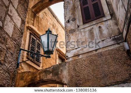 Street Lamp in the Narrow Street of Omis, Croatia - stock photo