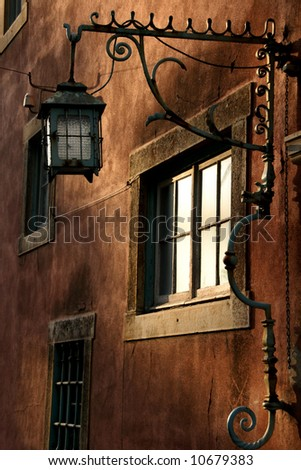 Street lamp in the portuguese town - stock photo