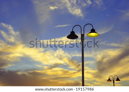 Street Lamp Of public Illumination Lighted In Los Angeles During Sunset - stock photo