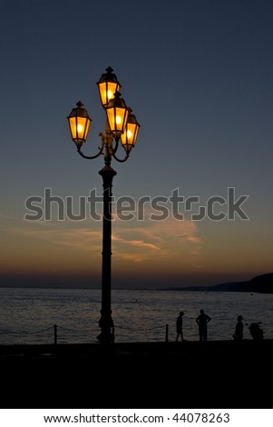 street lamp on a beach at evening - stock photo