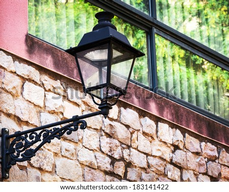 street lamp on the building background - stock photo