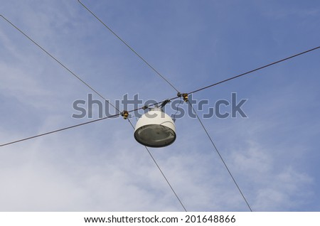 Street lamp suspended from steel cables