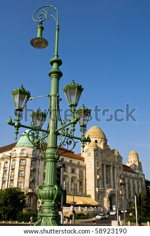 Street lamp with a beautiful hotel in Budapest, Hungary - stock photo