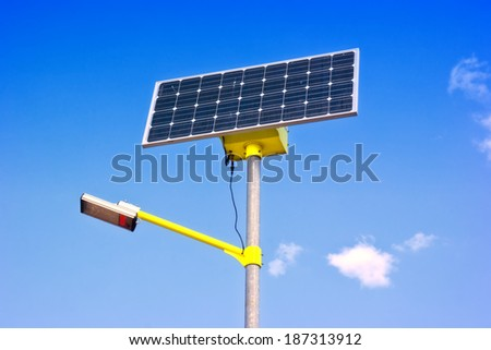 Street lamp with a sunny battery on a background sky - stock photo