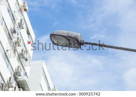 street lamp with apartment background, city lighting concept