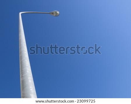 Street lamp with big blue sky - stock photo