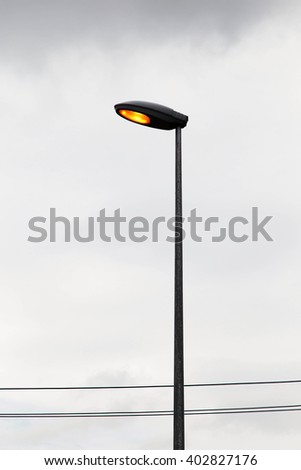 Street lamp with blue sky.