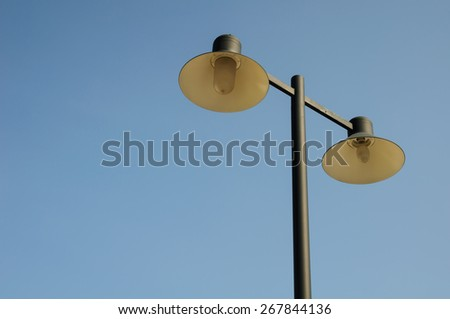 Street lamps on blue sky - stock photo