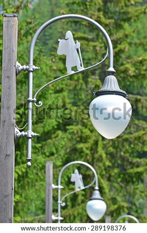 Street lamps on the via Francigena pilgrimage route from Canterbury to Rome, showing the symbol of the pilgrim. - stock photo