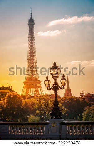 Street lantern on the Alexandre III Bridge against the Eiffel Tower in Paris, France - stock photo