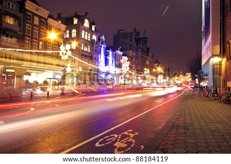 Street life by night in Amsterdam the Netherlands at christmas - stock photo