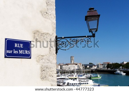 Street light above the old harbor in La Rochelle, France - stock photo