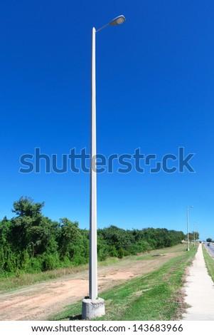 street light against the blue sky - stock photo