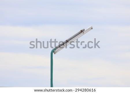 street light against the blue sky. - stock photo