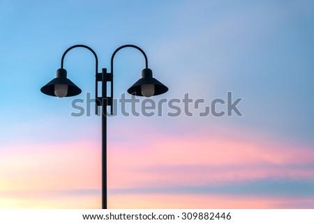 Street light against twilight or sunset background. - stock photo