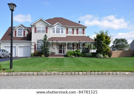 Street Light Lamp post on Curb of Suburban Luxury Two Story Two Car Garage Home - stock photo