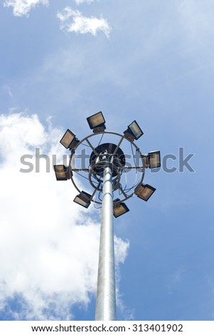 street light on stainless pole against a blue sky background.