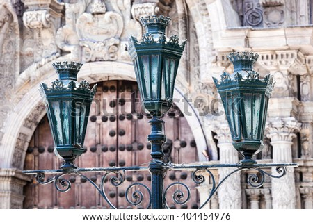 street light on the background of old church - stock photo