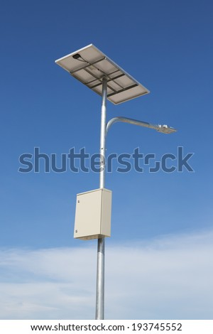 Street lighting with solar panels and wind generator - stock photo