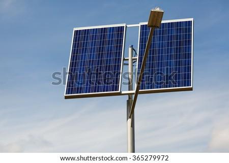 Street lighting with solar panels. Solar panels for powering street lamppost - stock photo