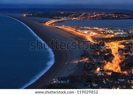 Street lights light up the causway at Chesil Beach Fortuneswell Portland Dorset - stock photo
