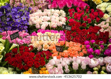 Street market in Japan. Closeup showing and array of bouquets in various colours and varieties at at flower stall.  - stock photo