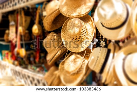 Street market selling hats and souvenirs in the touristic town of Varadero in Cuba photographed with a shallow depth of field - stock photo