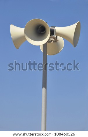 Street megaphones over the sky. Messages, warnings and communication system - stock photo
