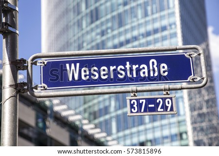 Street name Weserstrasse at the enamel sign on the post
