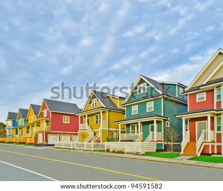 Street of new affordable houses. - stock photo