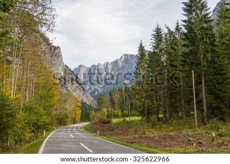 Street pass through the Gesaeuse mountain range and view into the Enns valley and the Hochtor massif. The Gesaeuse range is part of the Ennstal Alps and a national park in Styria, Austria - stock photo
