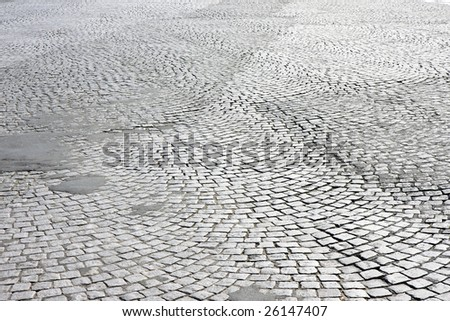 Street paved with cobblestone in Paris, France - stock photo