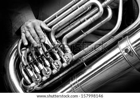 Street performer playing the tuba - stock photo