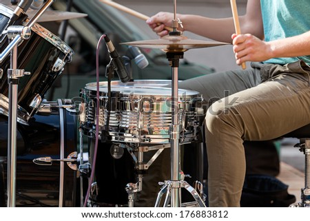 Street performing drummer playing drums - stock photo