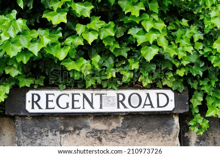 Street plate for Regent street on the stone wall with ivy in the city of Edinburgh - stock photo