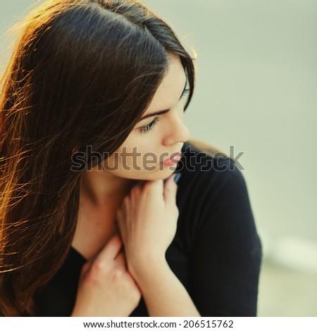Street portrait of brunette woman outdoor. - stock photo