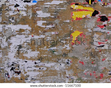 Street poster wall filled with paper bits - stock photo