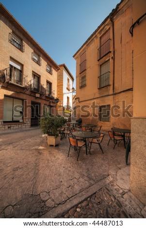 street restaurant in historical part of Toledo, Spain - stock photo