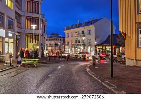 Street scene on Skolavordustigur street in downtown Reykjavik, Iceland, leading to the Hallgrimskirkja Church, one of the landmarks of the city. - stock photo